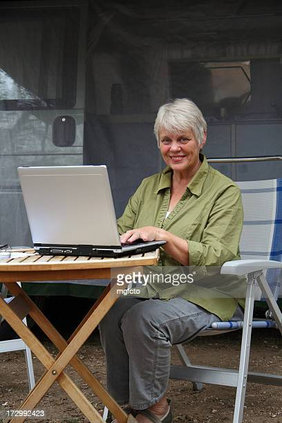 Active senior woman with laptop