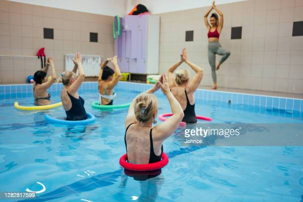 active senior women on the aqua aerobic class - leisure activity stock pictures, royalty-free photos & images