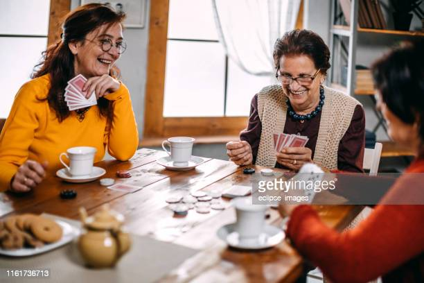 active senior women playing games at home - thinking of you card stock pictures, royalty-free photos & images