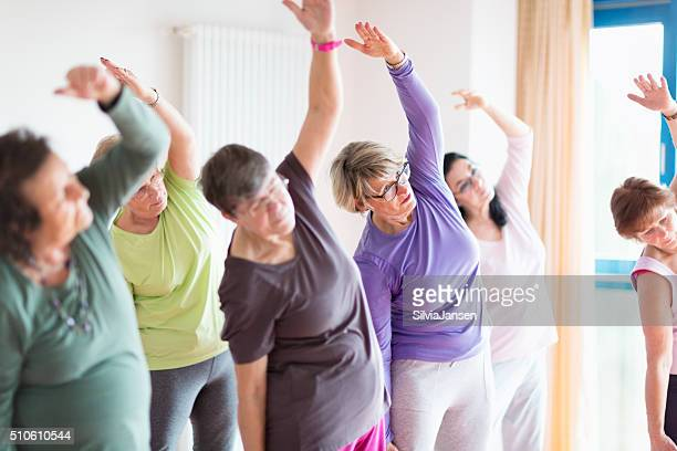active senior women yoga class - community centre stock pictures, royalty-free photos & images
