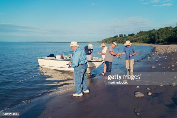 Active seniors brothers on a fishing trip.