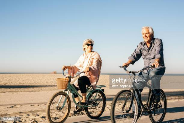Active seniors couple on bike