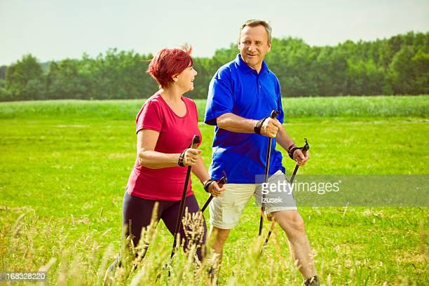 Active seniors doing nordic walking