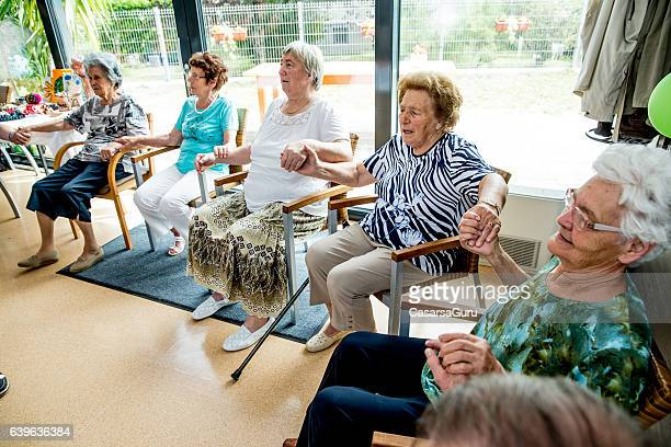 Active Seniors Exercising together in an Elderly Daycare Center