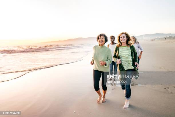 active seniors group on the beach - kate green stock pictures, royalty-free photos & images