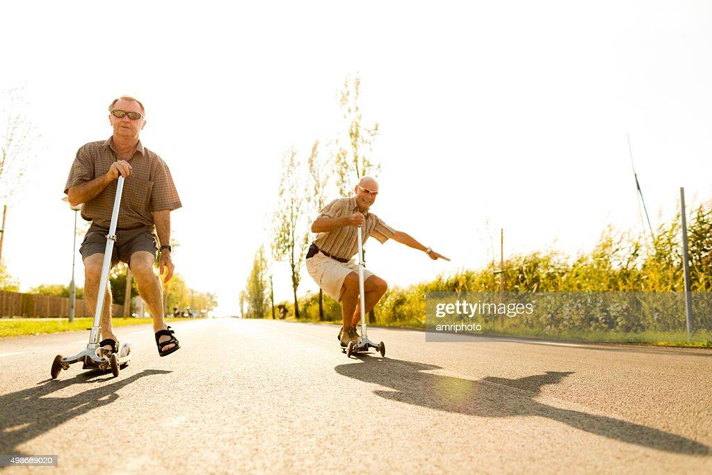active seniors on kickboards : Stock Photo