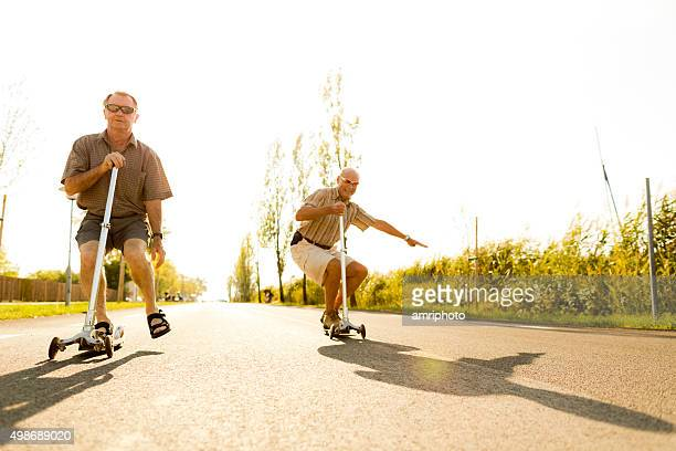 active seniors on kickboards - young at heart stock pictures, royalty-free photos & images