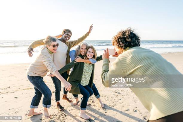 active seniors on the beach - kate green stock pictures, royalty-free photos & images
