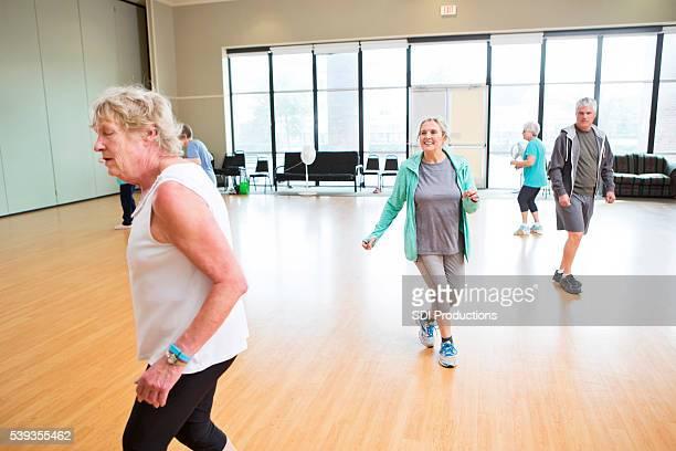 Active seniors particpate in dancing class