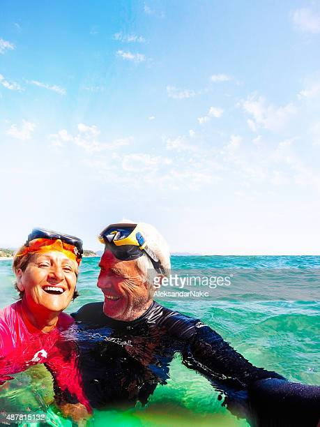 active seniors snorkelling - snorkeling stock pictures, royalty-free photos & images