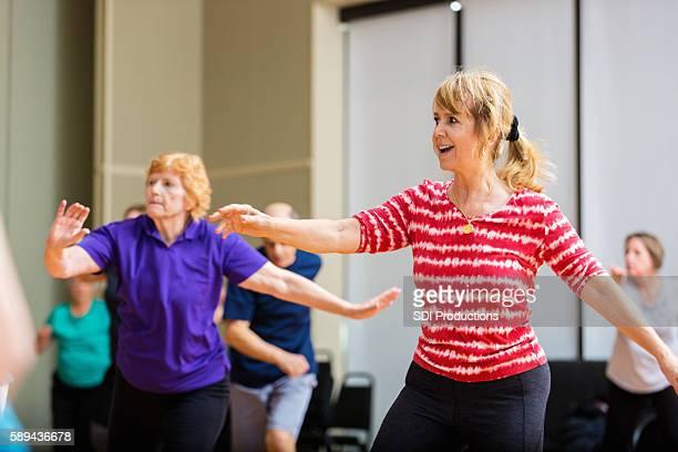 Active seniors take dance lessons at senior center