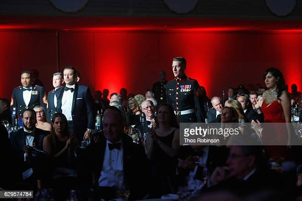 Active servicemembers rise for acknowledgement during the USO 75th Anniversary Armed Forces Gala Gold Medal Dinner at Marriott Marquis Times Square...
