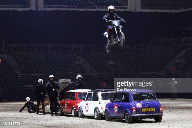 Active servicemen from the Royal Signals White Helmets practice a routine ahead of the British Military Tournament at Earls Court on December 1 2011...