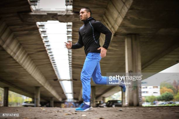 active sporty man. - one young man only stock pictures, royalty-free photos & images