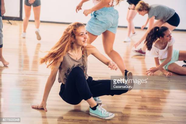 active teenage girls learning to dance choreography - rehearsal stock pictures, royalty-free photos & images