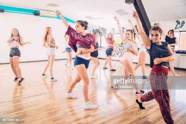 active teenage girls on dancing training - dance studio stock pictures, royalty-free photos & images