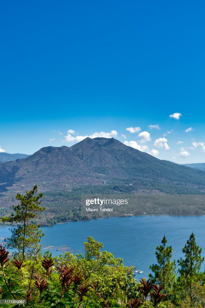 Active volcano and Lake Batur in the caldera : Stock Photo