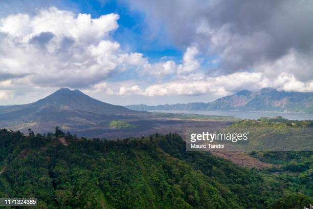 active volcano and lake batur in the caldera - mauro tandoi stock pictures, royalty-free photos & images