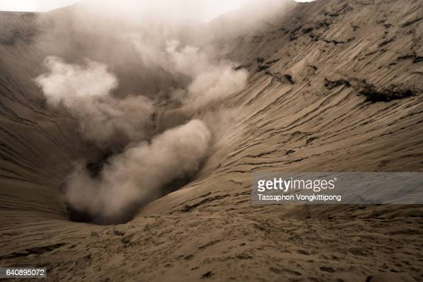 active volcano crater spit out gas and smoke