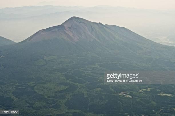 Active volcano Takachiho in Kirishima mountains daytime aerial view from airplane