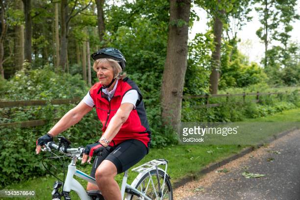 active woman cycling in the countryside - morpeth stock pictures, royalty-free photos & images