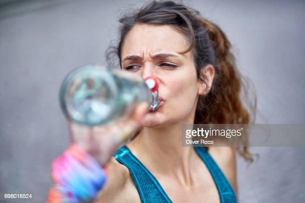 active woman drinking water from bottle - thirsty stock pictures, royalty-free photos & images