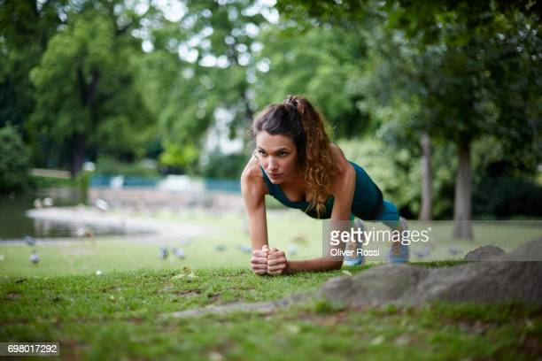 Active woman exercising in park