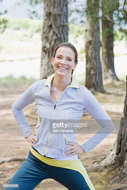 Active woman stretching in remote area