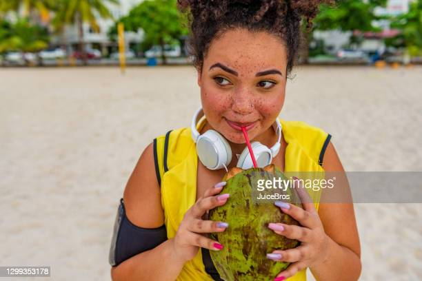 active young brazilian sports woman - coconut water stock pictures, royalty-free photos & images