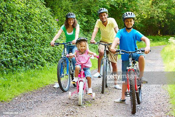 Active young family enjoying bike ride in the country