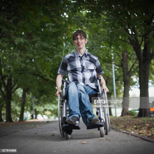 Active young man in wheelchair