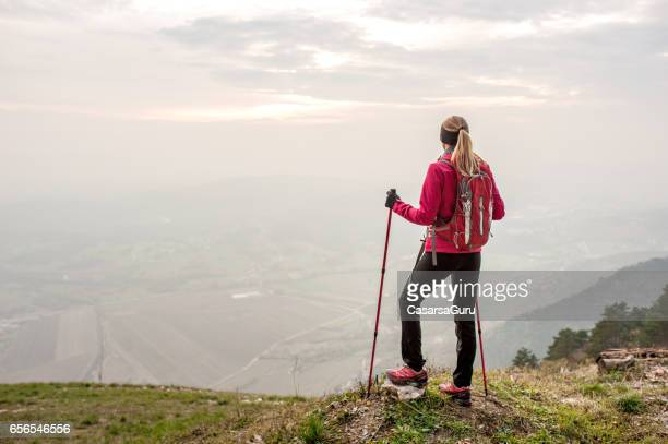 Active Young Woman At The Top Of The Plateau Enjoy The Beautiful View
