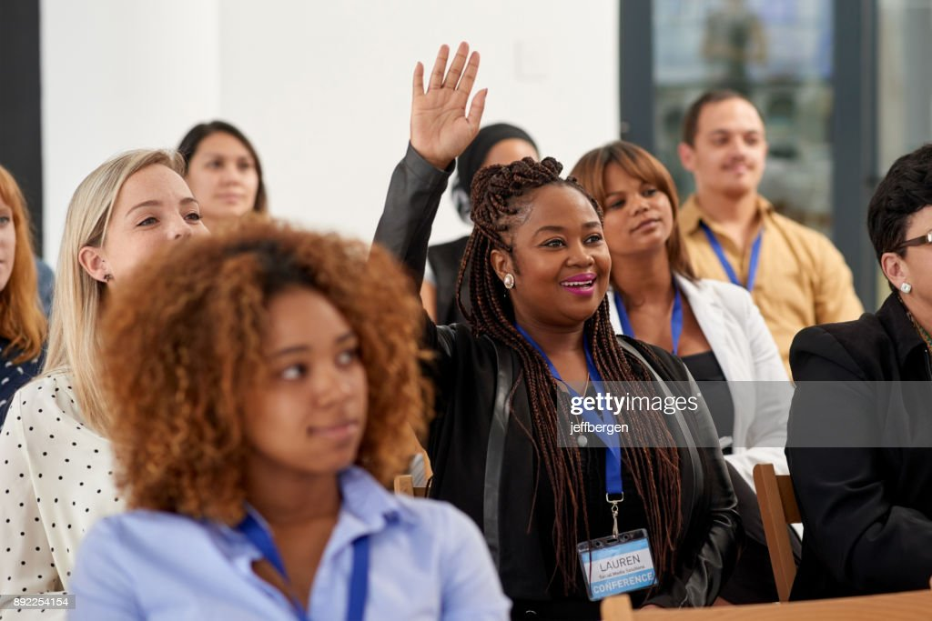 Actively participating in the conference : Stock Photo