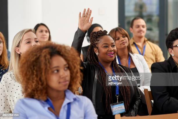 actively participating in the conference - arms raised stock pictures, royalty-free photos & images