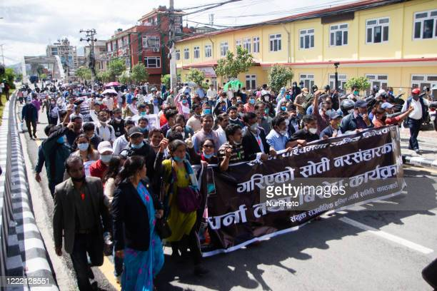 Activist affiliated to various Dalit organization protest against killing of Dalit low-caste youth in Rukum district during lockdown in Kathmandu,...