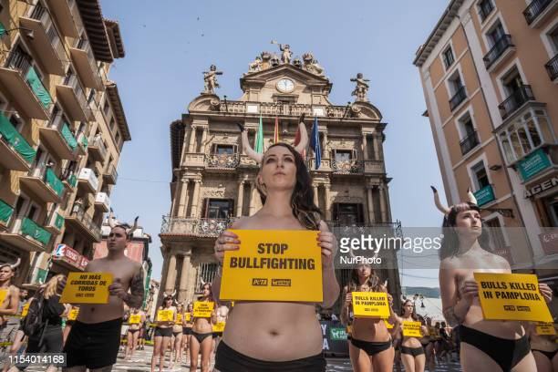Activist against animal cruelty holds a banner anti bullfightings during a performance before the San Fermin celebrations in Pamplona Spain on July 5...