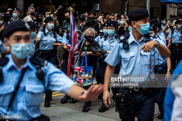 Activist Alexandra Wong , also known as Grandma Wong, is taken away by police while protesting on the 24th anniversary of Hong Kong's handover from...