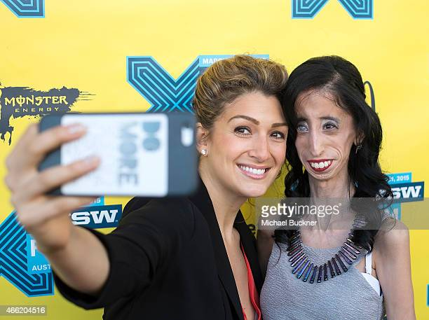 Activist Alexis Jones and Lizzie Velasquez arrive at the premiere of A Brave Heart The Lizze Velasquez Story at Paramount Theatre on March 14 2015 in...