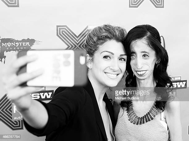 Activist Alexis Jones and Lizzie Velasquez arrive at the premiere of 'A Brave Heart The Lizze Velasquez Story' at Paramount Theatre on March 14 2015...