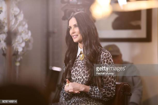 Activist and actress Demi Moore speaks with the press as she is honored by Visionary Women in celebration of International Women's Day on March 8...
