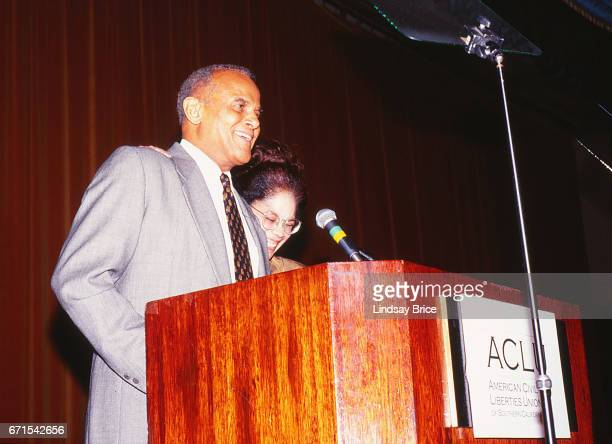 """Activist and entertainer Harry Belafonte introduces his friend, civil rights activist and attorney, honoree Constance L. """"Connie"""" Rice, at the podium..."""