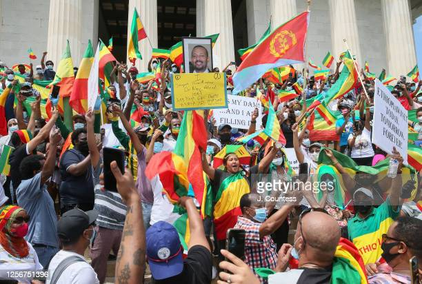 Activist and members of the Ethiopian community representing multiple ethnic groups gather on the steps of the Lincoln Memorial after a protest to...