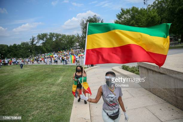 Activist and members of the Ethiopian community representing multiple ethnic groups march to the steps of the Lincoln Memorial after a protest to...