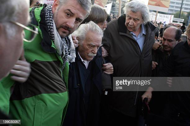 Activist and writer Manolis Glezos and Mikis Theodorakis take part in a demonstration outside the Greek parliament in Athens on February 12 against...