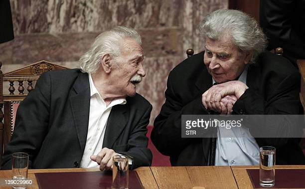 Activist and writer Manolis Glezos sits next to composer Mikis Theodorakis in the Greek parliament in Athens on February 12 2012 Glezos an emblematic...