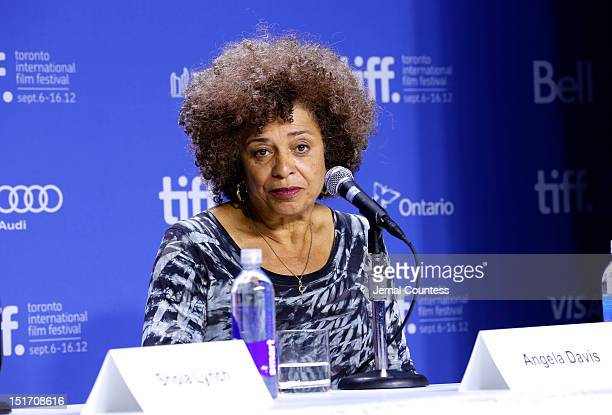 """Activist Angela Davis speaks onstage at the """"Free Angela & All Political Prisoners"""" Press Conference during the 2012 Toronto International Film..."""