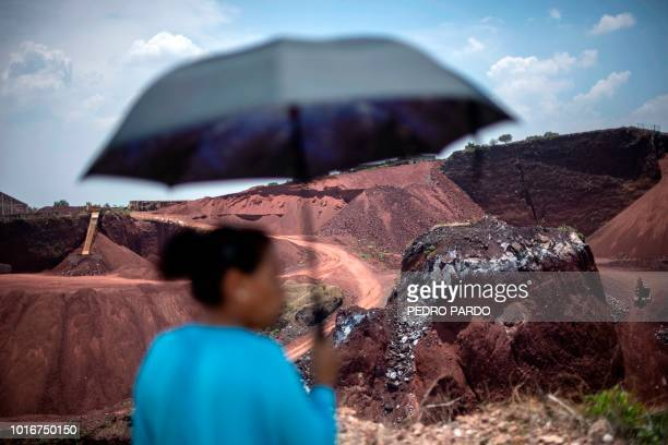 Activist Angelica Maria Gonzalez looks at El Tezoyo quarry where tezontle and other stones are extracted for the construction of the new...
