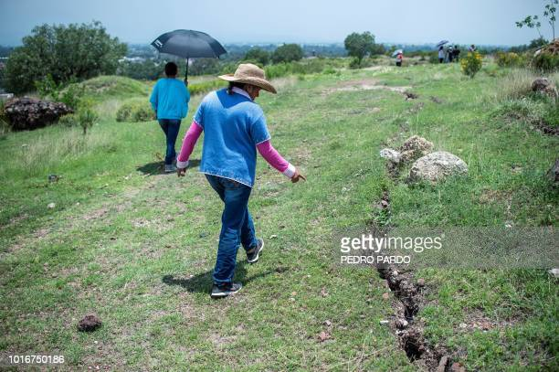 Activist Angelica Maria Gonzalez shows a crack near El Tezoyo quarry where tezontle and other stones are extracted for the construction of the new...