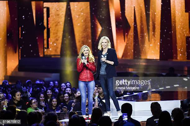 Activist Ashley Murphy and actress Charlize Theron speak onstage at WE Day California 2016 at The Forum on April 7 2016 in Inglewood California