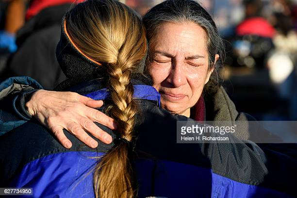 Activist Brenda Cohen cries tears of joy as she celebrates at Oceti Sakowin camp on the Standing Rock Sioux Reservation on December 4, 2016 in Cannon...